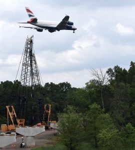 A British Airlines flight glides to a landing over the Silver Line construction zone at the northern edge of Dulles Airport.