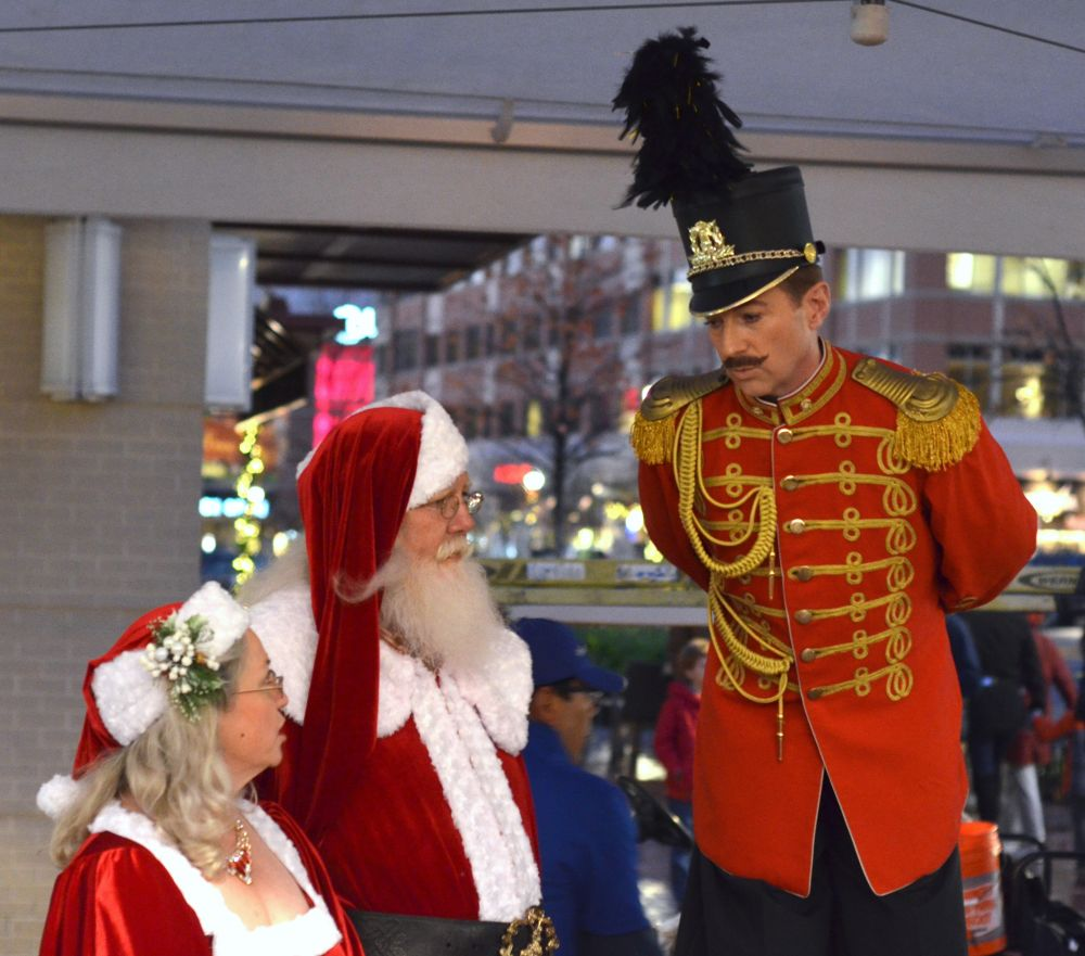Santa and Mrs. Claus hang with a toy soldier ahead of the tree lighting ceremony at Village at Leesburg.  [Danielle Nadler/Loudoun Now]