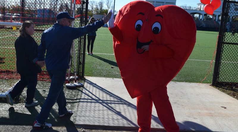 A high-five was a reward for participants who completed the 3-mile walk.