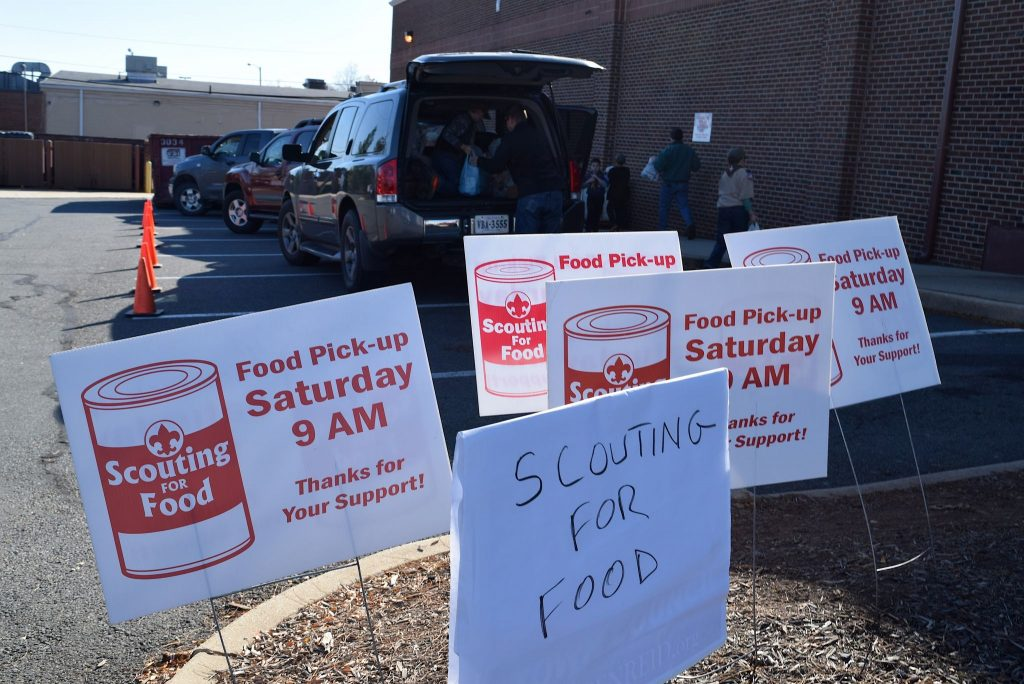 Trucks line up to drop off donations that the Loudoun Hunger Relief collection site in Leesburg.