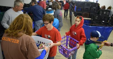 Scouts and volunteers sort donations at the Loudoun Hunger Relief collection site in Leesburg.