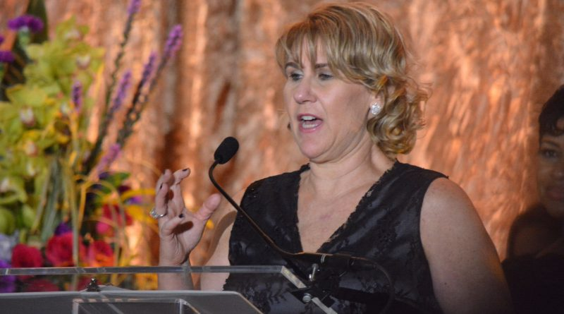 Nanette Parsons of Best Rack Around accepts the Retail Business of the Year award.