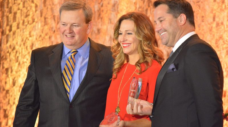 The Wellness Collection founder Susan McCormick accepts the Service Business of the Year award.