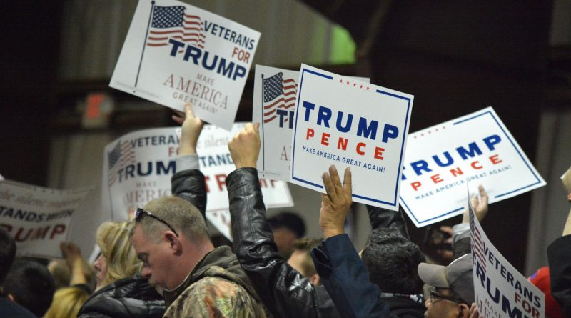 Supporter wave signs during the Trump rally near Leesburg. [Norman K. Styer/Loudoun Now]