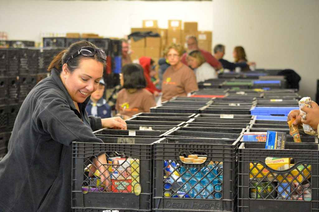 Volunteers sort donations at the Loudoun Hunger Relief collection site in Leesburg.