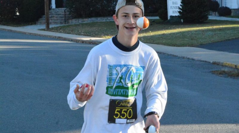 Adam Conklin showed off his juggling talents while running the 5K and finished 10th overall.