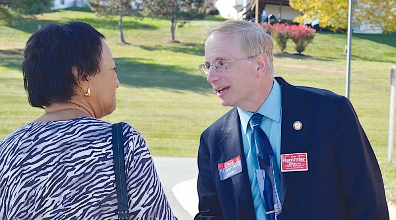 Former Leesburg mayor and candidate Dave Butler shakes hands at Evergreen Mill Elementary School on election day. [Danielle Nadler/Loudoun Now]