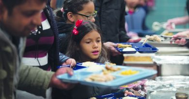 Sisters Gaby and Melany Cabrera, of Sterling, get pumpkin pie. [Douglas Graham/Loudoun Now]