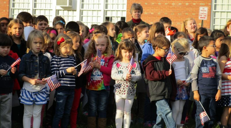 Aldie Elementary School held a ceremony honoring veteran parents and grandparents.  The kids sang all the Armed Forces songs around the flag pole as the vets looked on.  Cub Scout Pack 1737 was in charge of the flag raising. [Jay Bradshaw]