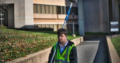 Matt Murphy, a Project SEARCH intern and Loudoun County High School graduate, tidies up the grounds of the National Conference Center. [Douglas Graham/Loudoun Now]