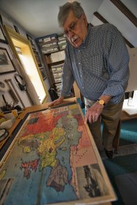 William Teringo displays a vintage map at his downtown Leesburg gallery.