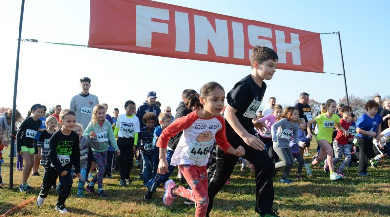 Runners take off at the start of the one-mile fun run at the 14th annual Freeze Your Gizzard at Ida Lee Park. (Renss Greene/Loudoun Now)