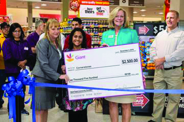 From left, Dawn McFarland, Sterling Town Center Plaza Giant store manager presents a check to Saira Sufi, director of Volunteers and Community Engagement for Cornerstones, and Susan Garvey, senior director for Donor Relations for Cornerstones, during the store's Nov. 4 grand reopening.