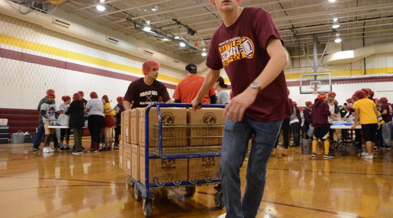 Stop Hunger Now boxes go around the world to help needy people. In 2015, the organization sent meals to 37 countries. (Renss Greene/Loudoun Now)