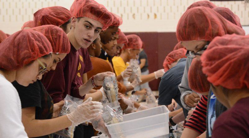 Broad Run High School students worked assembly line-style to package 20,000 meals. (Renss Greene/Loudoun Now)