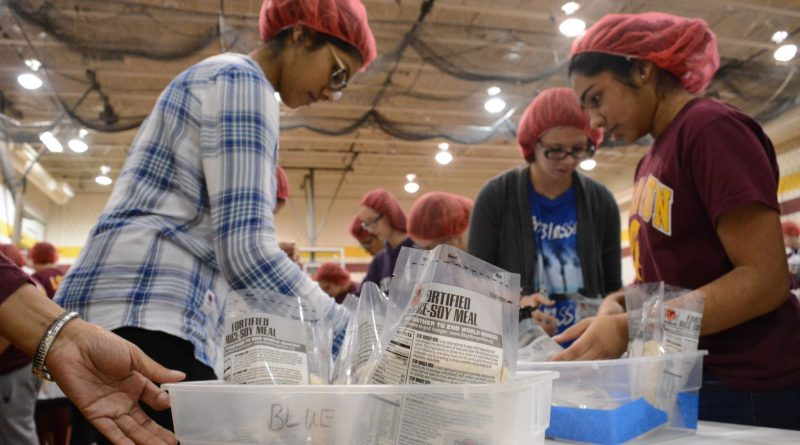 The meal packages include rice, soy flour, dehydrated vegetable mix, and a vitamin packet. (Renss Greene/Loudoun Now)