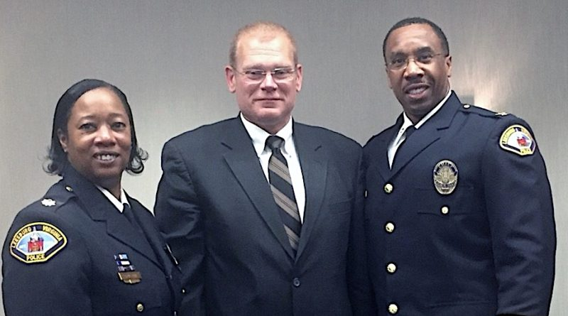 Lt. Patrick Daly is flanked by Leesburg Police Chief Gregory Brown and Deputy Chief Vanessa Grigsby.