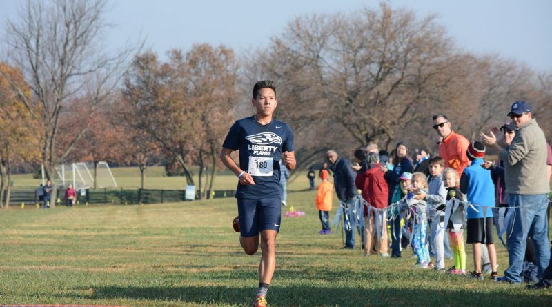 Josh Showalter of Leesburg finishes the Freeze Your Gizzard Cross Country 5K so far ahead of any other finishers that they are not in sight when he crosses the finish line. Showalter finished the 5K in 15:40, fully a minute and ten seconds ahead of the next finisher. (Renss Greene/Loudoun Now)
