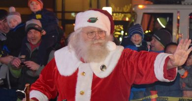 Santa arrives at the plaza with a little help from the Sterling Volunteer Fire Department.