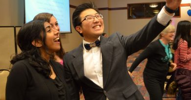 Rock Ridge High School students Andrew Zheng, Maya Ramani and Brandie Young take a selfie during the Excellence in Education Banquet on Sunday. [Danielle Nadler/Loudoun Now]