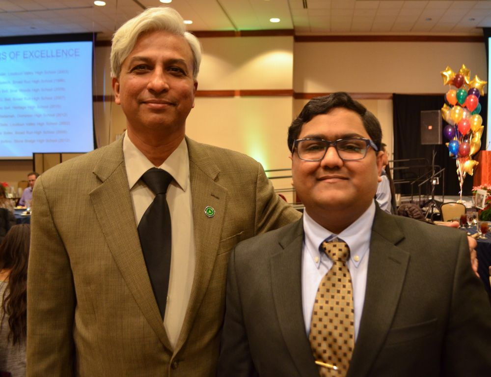Excellence in Education Banquet honoree Dhyey Parikh poses with his guest Academy of Science teacher Sundar Thirukkurugun. [Danielle Nadler/Loudoun Now]