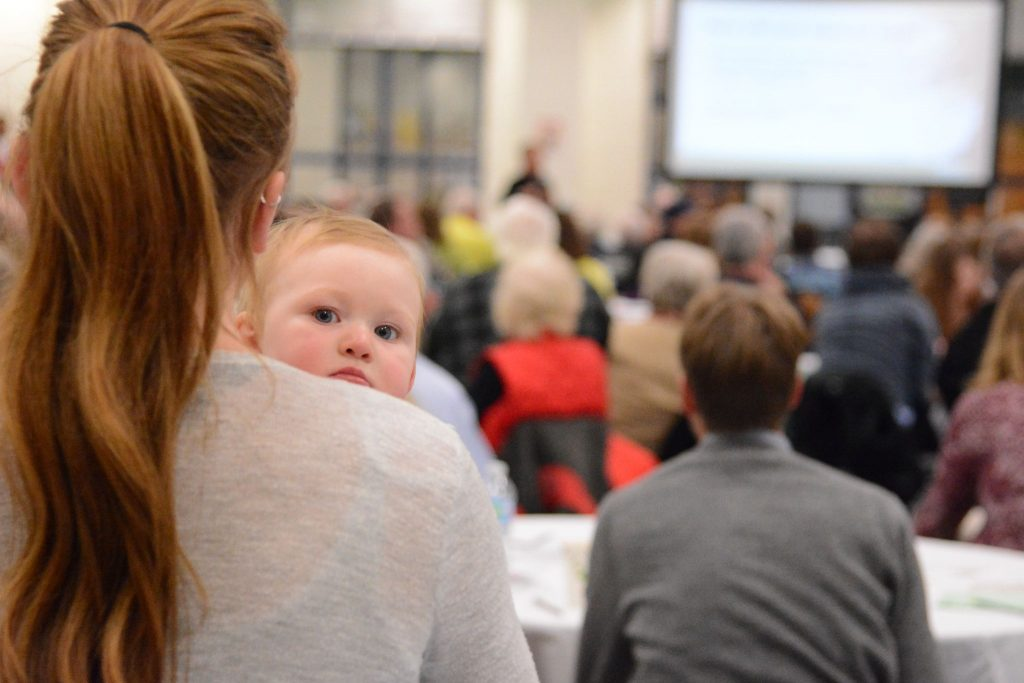 The youngest attendee at an Envision Loudoun session at Woodgrove High School Monday, Dec. 5. (Renss Greene/Loudoun Now)