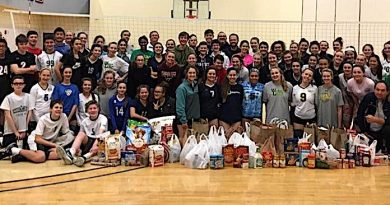 Volleyball Club Donates Food, Pet Pantries