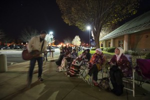 UNITED STATES - November 16, 2015: This was the scene at 4 a.m. in the parking lot of the Ida Lee Recreation Center in Leesburg Virginia as people lined up waiting for tickets to go on sale at 5 a.m. The Jingle Jam evening show has sold out at 5:30 am. Here musician Todd Wright plays some Christmas songs at around 4 a.m. to folks waiting in line as a way of thanking them for coming out and supporting Juvenile Diabetes Research Foundation. All proceeds from the event go to the cause. (Photo By Douglas Graham/Loudoun Now)