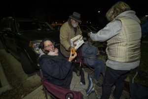 UNITED STATES - November 16, 2015: This was the scene at 3 a.m. in the parking lot of the Ida Lee Recreation Center in Leesburg Virginia as people lined up waiting for tickets to go on sale at 5 a.m. The Jingle Jam evening show has sold out at 5:30 am. Here Stilson Greene hands out donuts at around 4 a.m. to folks waiting in line as a way of thanking them for coming out and supporting Juvenile Diabetes Research Foundation. All proceeds from the event go to the cause. (Photo By Douglas Graham/Loudoun Now)