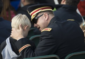 UNITED STATES - November 11, 2015 : The George C. Marshall International Center, the Town of Leesburg, and Loudoun County held a commemorate Veterans Day ceremony on the grounds of The Marshall House. Here Army MAJ. Brett Sweeney and his son Blake age 6 enjoy the ceremony on the grounds of The Marshall House. (Photo By Douglas Graham/Loudoun Now)