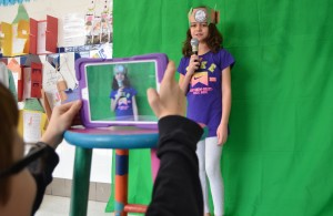 Using a school-provided tablet, Liberty Elementary third-grader John Shilling helps classmate Nellia Kakar record a video about ancient Greece. (Danielle Nadler/Loudoun Now)