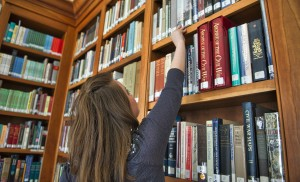 Stephanie Walters looks for a book in one of the many book selves at the Thomas Balch Library in Leesburg. (Photo by Douglas Graham/Loudoun Now)