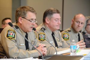 Sheriff Michael Chapman, alongside Lt. Cols. Robert Buckman and Mark Poland, speaks to the Board of Supervisors at a budget work session March 7. (Renss Greene/Loudoun Now)