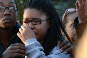 Christina Fisher's daughter, Natajia, weeps during a vigil in her mother's honor April 4. (Danielle Nadler/Loudoun Now)