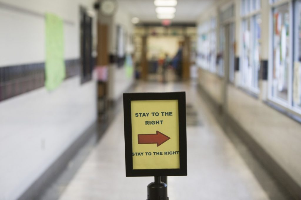 A rare quiet moment in a Mercer Middle School hallway shows the traffic signals created by staff to help students change classes in under 5 minutes. (Ali Khaligh/Loudoun Now)