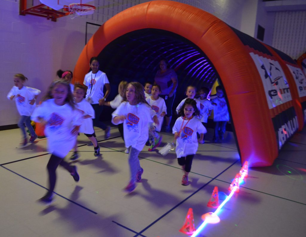 Ball's Bluff Elementary students bolt through a course in the school's gym Thursday to raise money for a track. (Danielle Nadler/Loudoun Now)