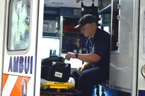 A firefighter EMT preps an ambulance for service Tuesday afternoon at the Loudoun County Volunteer Rescue Squad station on Catoctin Circle in Leesburg. (Danielle Nadler/Loudoun Now)