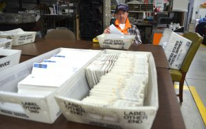 An ECHOworks client sorts mail at the nonprofit organization's Leesburg facility. (Danielle Nadler/Loudoun Now)