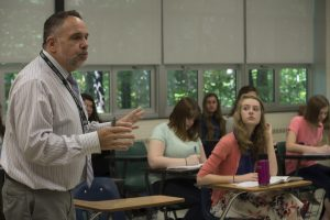 Michael Krepich, a 36-year Latin teacher, leads a class at Loudoun Valley High School on Monday. The classical language is seeing a major revival among Loudoun public middle and high school students. [Douglas Graham/Loudoun Now]