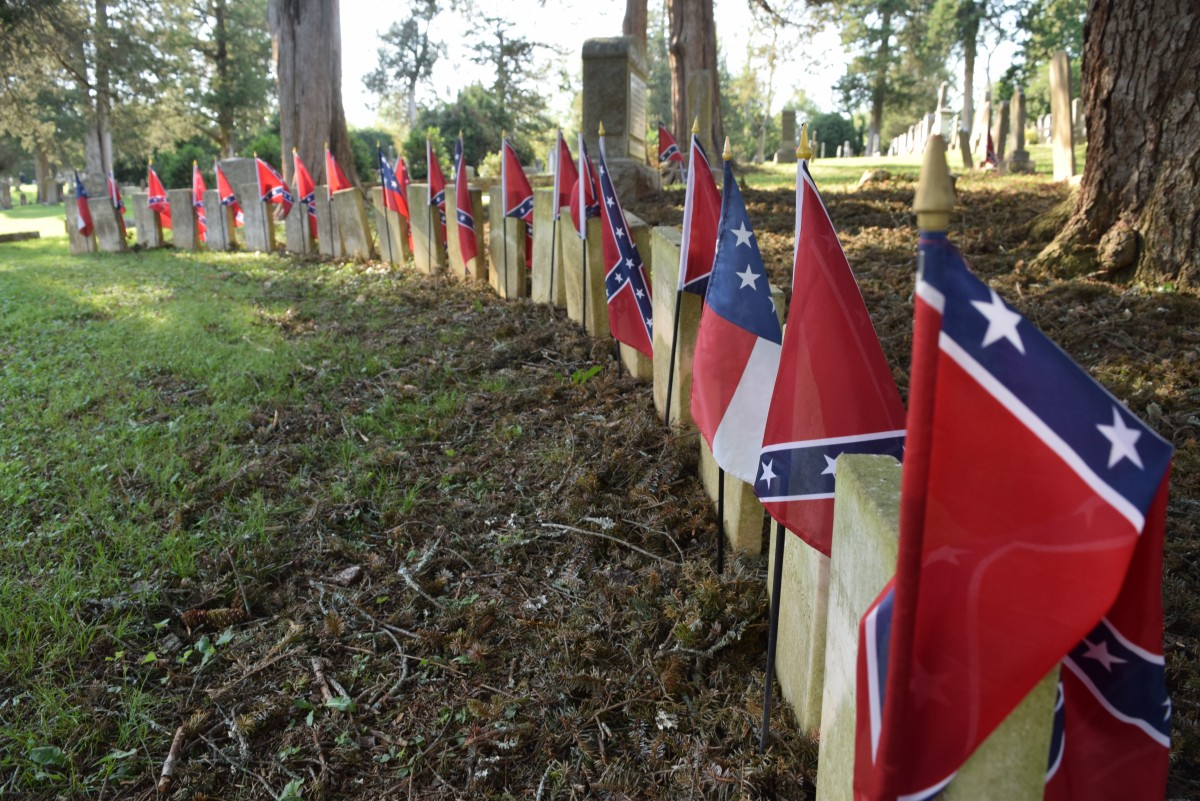 Battle flags mark gravestones of 80 unknown solders at a monument in Sharon Cemetery in Middleburg.