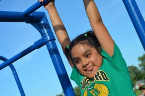 Guilford third-grader Brittany enjoys a moment off the ground at the school's birthday celebration. (Danielle Nadler/Loudoun Now)