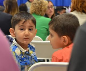A young boy waits patiently for the iftar to start at the All Dulles Area Muslim Society in Sterling on Monday. (Danielle Nadler/Loudoun Now)