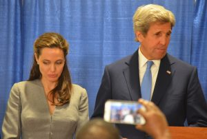 Actress and United Nations High Commissioner for Refugees Special Envoy Angelina Jolie and U.S. Secretary of State John F. Kerry take part in a prayer at the All Dulles Area Muslim Society in Sterling on Monday. (Danielle Nadler/Loudoun Now)