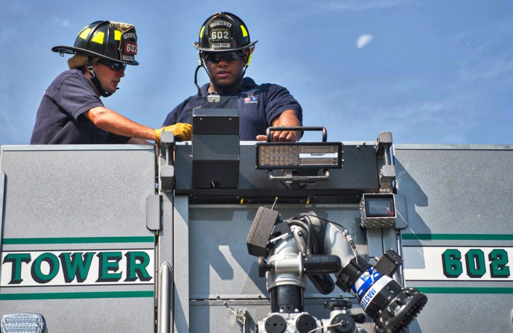 Firefighters Gallahan and Black get some training time in on Tower Truck 602 of the Purcellville Public Safety Center in Purcellville, Virginia. (Douglas Graham/Loudoun Now)