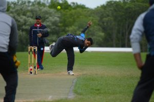 Loudoun Tigers bowler Alok Mudhale throws during a cricket match at Phillip A. Bolen Park in Leesburg. Cricket, one of the world's most played sports, is gaining popularity in Loudoun. [Renss Greene/Loudoun Now]