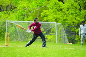 Lazy Lions batsman Chandra Shekar Tady takes a swing. [Renss Greene/Loudoun Now]