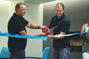 Chuck Smith and Eric Pearson cut the ribbon open Pearson Smith Realty's new office at Loudoun Station.