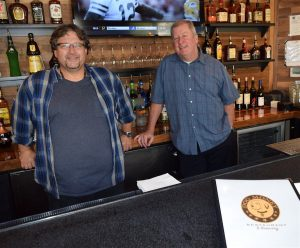 Dog Money Restaurant & Brewery partner Tim Regan, right, and Dean Lake say patrons will see the menu and range of services expand at the Catoctin Circle venue in the weeks ahead following a soft opening last weekend.