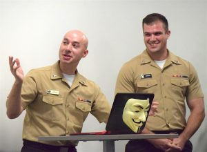 CTN2 D. Espree, left, and CTN2 J. Johnson prepare to execute a computer hack in front of a audience of judges as part of their demonstration of their industrial control system cyber security platform.
