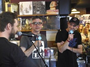 Jim Lenahan, center, and Patrick Foster, right, stop at a Nashville record store on their musical road trip last spring. [USA Today]